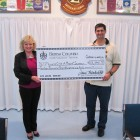 MLA Jane Thornthwaite (L)  presents President Arif Datoo (R) a $13,340 Community Gaming Grant Cheque
