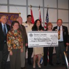 Presidents of the Lions Clubs of the North Shore  and Zone Chair Bob Rasmus receiving a cheque from MLA Naomi Yamamoto