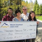 Lions Arif Datoo and Dennis Simpson present a cheque for $4000 to Lisa Reinders and Susan Bowering representing Parkgate Community Services Society for the Kids Up Front Foundation